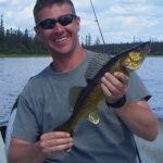 Man posing with a walleye fish
