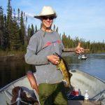 Man posing with a walleye fish