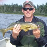 Man posing with walleye fish