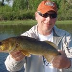 Man posing with a walleye