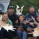 Family holding moose rack