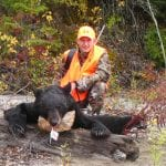 hunter with a bear