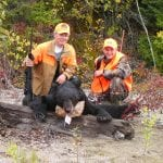 2 hunters with a bear