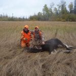 2 men posing with their bull moose catch