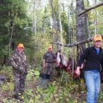 friends posing with their bull moose