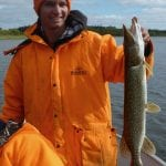Man posing with a pike