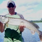 Man holding a pike