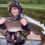 boy holding a pike