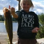 Child posing with huge walleye catch