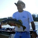 Man posing with a monster walleye