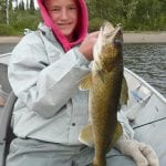 Boy posing with a walleye fish